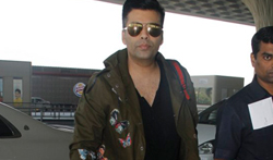 Karan Johar snapped at the airport - Pictures