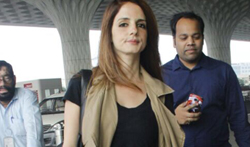 Sussanne Khan snapped at the airport - Pictures
