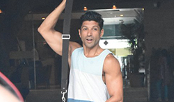 Farhan Akhtar snappped post his gym session in Bandra - Pictures