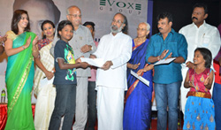 Varalaxmi Sarathkumar and Director Perarasu at 50 Lakhs Scholarship for Poor Students - Pictures