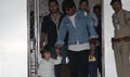 Shah Rukh Khan arrives with Abram after promoting 'Raees' in Ahmedabad